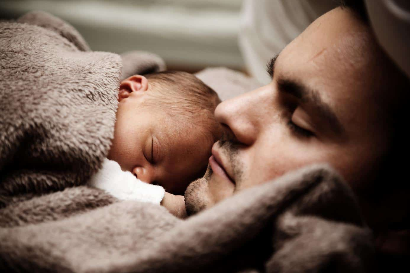 Father and sleeping baby