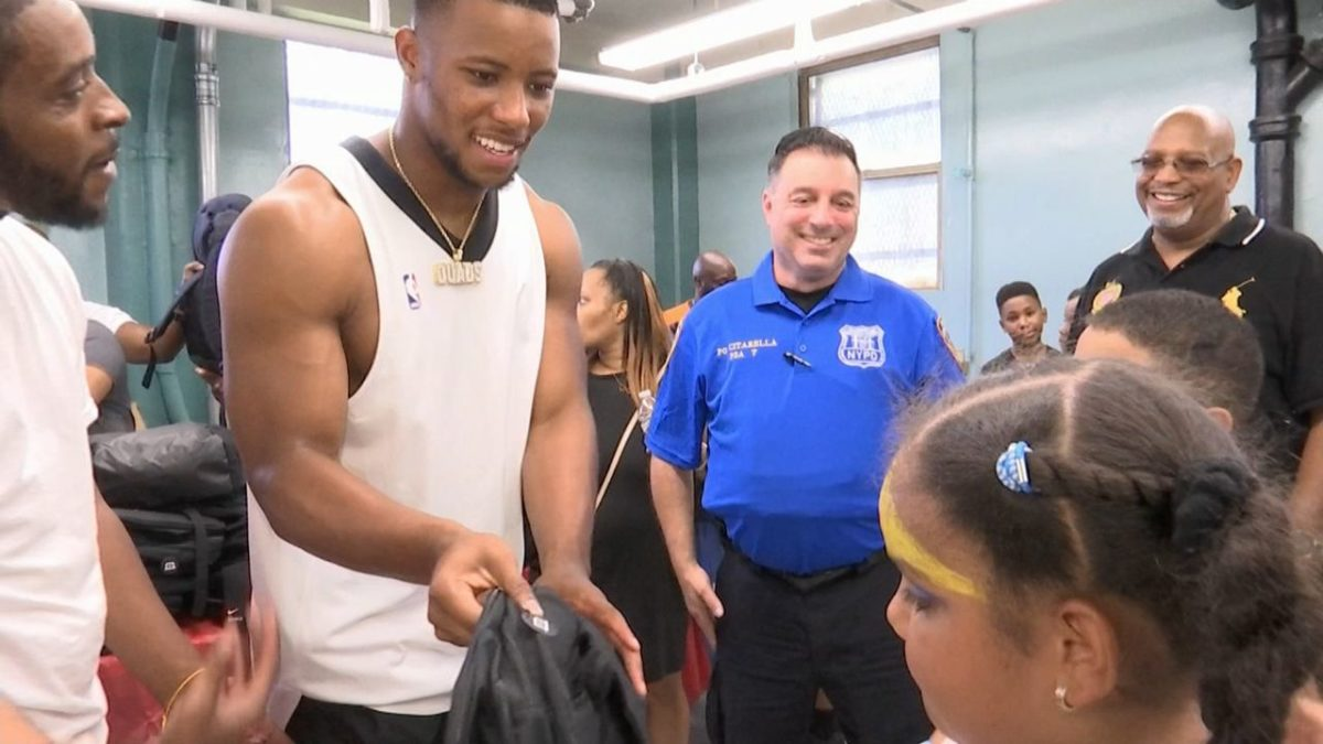 Giants Star Running Back Gives Back to the Bronx Community with Book Bags and School Supplies